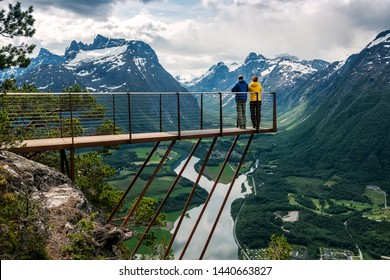 Two people are looking down from the observation deck rampestreken. Norway. Andalsnes