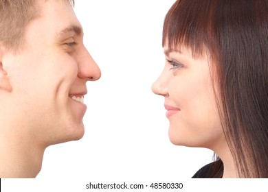 Two people looking at each other on white background