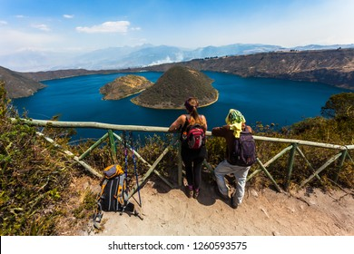 Two people looking towards the Cuicocha lagoon