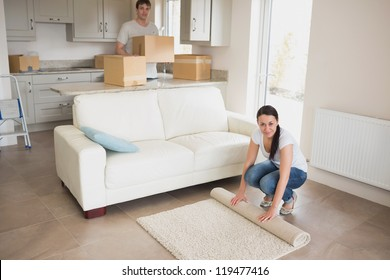 Two people moving into their house and furnishing the kitchen and living room