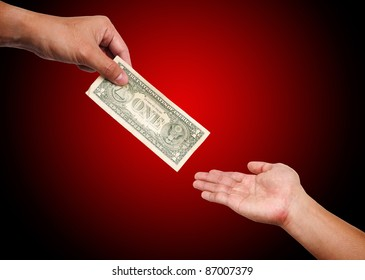 Two people passing  dollar bill from hand to hand