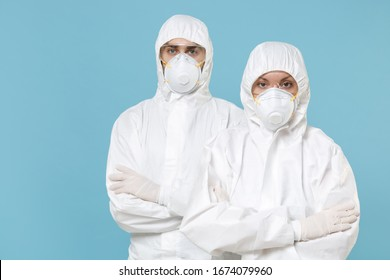 Two people in protective suits respirator masks isolated on blue background studio. Epidemic pandemic new rapidly spreading coronavirus 2019-ncov originating in Wuhan China medicine flu virus concept - Shutterstock ID 1674079960