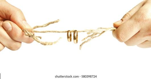 Two people pulling the rope and two golden rings in the middle of the cord