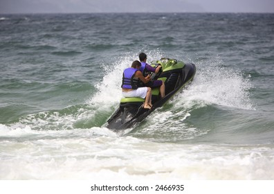 Two people riding a jet ski off shore