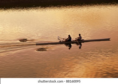 two people rowing on a river