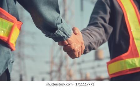 Two people Shake hand teamwork partnership Engineer Supervisor foreman