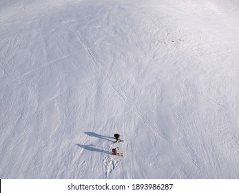 Two people skiing from a drone