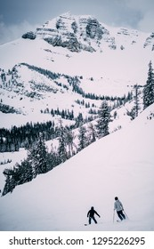 Two people skiing in Jackson Hole, Wyoming