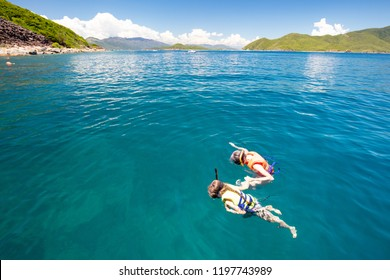 Two people snorkel off the island of Hon Mun near Nha Trang in Vietnam