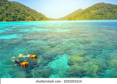 Two people are snorkeling in the sea of Surin island  in Thailand