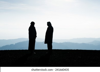 Two people talking about the future and making agreement. Landscape in the background