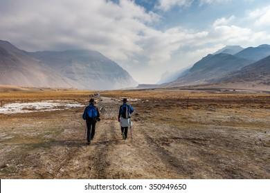 Two people walking to Mount Kailash in Tibet