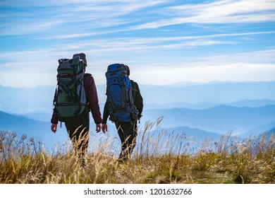 The two people walking on the mountain