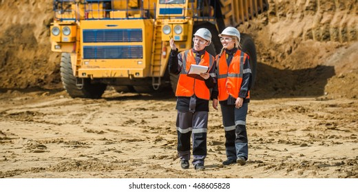 Two people working