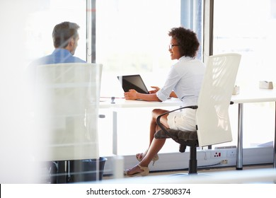 Two people working in a modern office