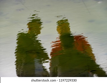 two person Reflections in the Water
