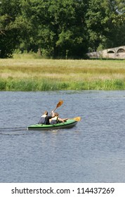 Two person swim with canoe