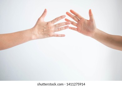 Two persons clapping hands together for say hi on white background; or slapping for replaced when change the player in sport game.