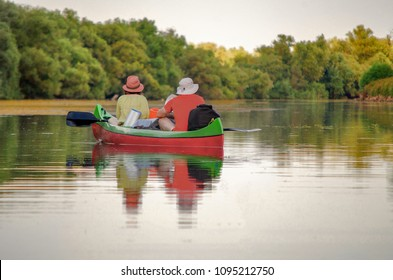 Two persons enjoying Danube Delta in a boat Canoe