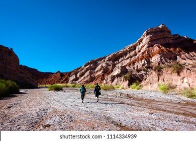 two persons hiking at the quebrada de cafayate or quebrada de las Conchas, Salta, Argentina