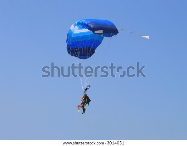 two persons with parachute
