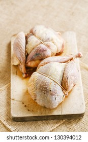 two pheasants bird, plucked and stuffed on wood