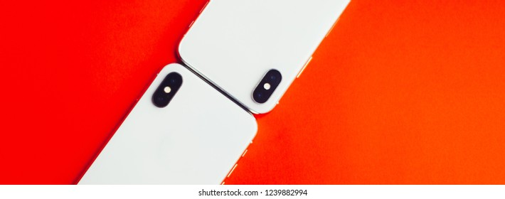 Two phones on a red background background