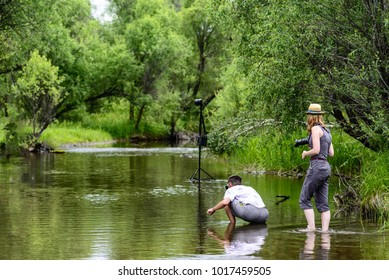 two photographers ready to shoot by the river