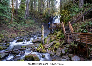 Two photographers taking photos of McDowell creek and McDowell Falls near Sweet Home Oregon