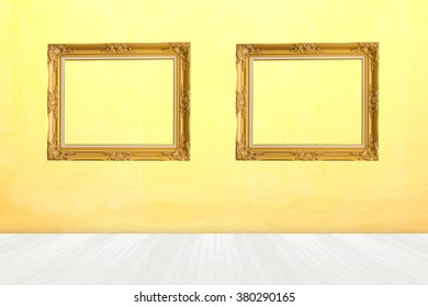 two photos frames in room with white wood floor with yellow concrete texture wall for background