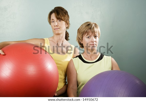 Two Physically Fit Women Posing Exercise Stock Photo Edit Now 14950672 According to researchers, women who are physically fit and exercise regularly during midlife are almost 90% less likely to develop dementia later in life than those who were moderately fit. shutterstock