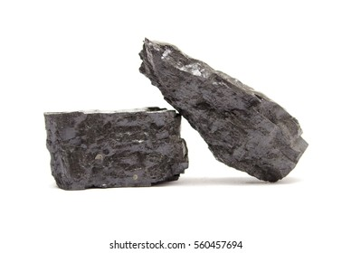 Two pieces of anthracite coal on white. Coal is one of the most common fossil fuels and is a major component in the production of electricity in the world.