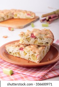 Two pieces of biscuit cake with rhubarb on a plate