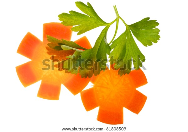 Two pieces of carrot in the form of stars, and a sprig of parsley. Isolated on white background.