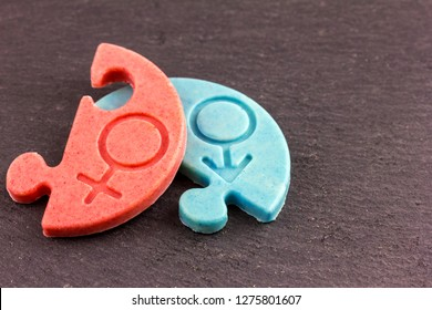 two pieces of chocolate with a symbol (male and female)