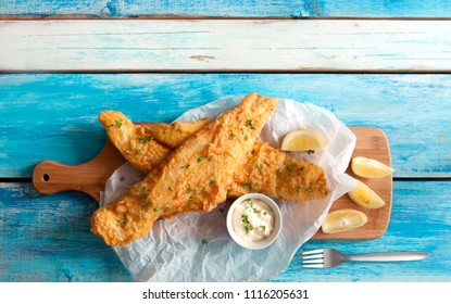 Two pieces of cod fried in batter