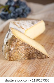 Two pieces of french hard cow or goat cheese Tomme or Tome, produced in French Alps