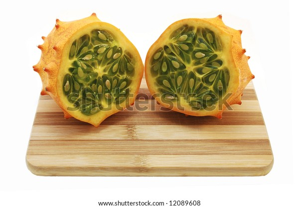Two Pieces of Kiwano on Cutting Board