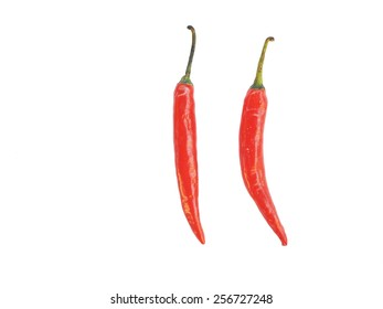 two pieces of red hot chilli vertically positioned and isolated on a white background