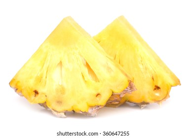 two pieces of ripe pineapple isolated on white background