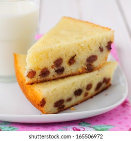 Two Pieces of Semolina Cake with a Glass of Milk, square