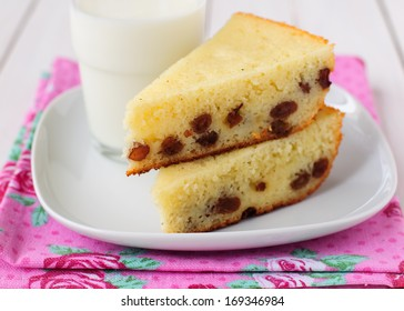 Two Pieces of Semolina Cake with a Glass of Milk