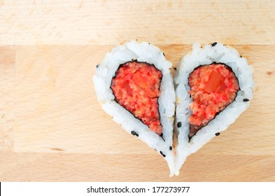 Two pieces of sushi forming the heart shape
