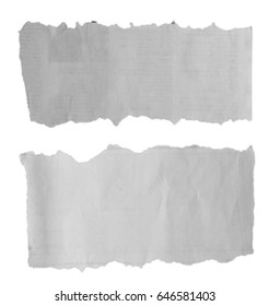 Two pieces of torn paper on plain background