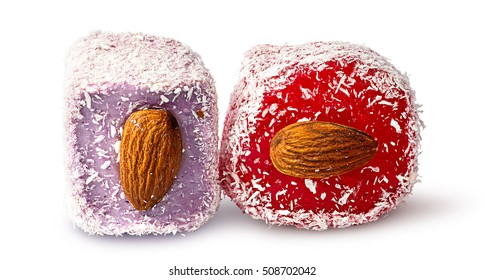 Two pieces of Turkish Delight with almonds beside isolated on white background