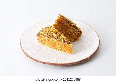 two pieces of wafer cake cake with condensed milk isolated on white background.