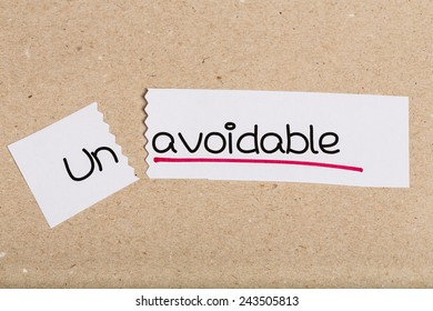 Two pieces of white paper with the word unavoidable turned into avoidable