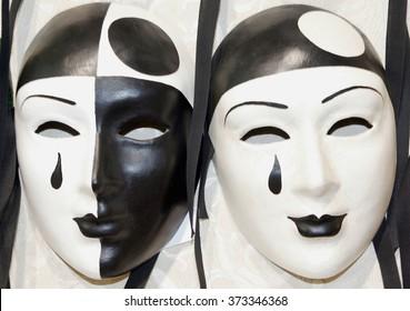 two pierrot masks like ying and yang