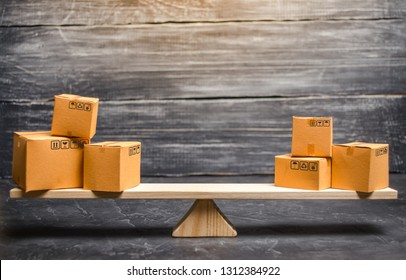 Two piles of boxes on the scales. Trade balance and calculation by barter. Bypassing sanctions, import and export of goods. Trade balance. Goods turnover between two subjects or countries.