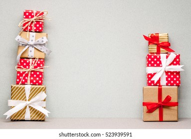 two piles of different christmas gifts on craft paper